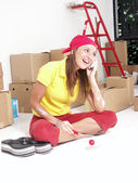 Hispanic woman moving to a new home. Hispanic woman moving and working at her new home. — Stock Photo