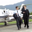 Business working at private jet - Stock Photo