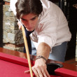 Young man plays billiards — Stock Photo #14609631