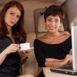 Stock Photo: Two women working inside private jet