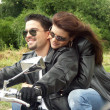 Royalty-Free Stock Photo: Couple enjoying a ride by motorcycle