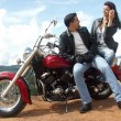 Young couple sharing in a motorcycle — Stok fotoğraf