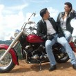 Young couple sharing in a motorcycle — Stock Photo #14609989