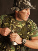 Soldier holding a gun — Stock Photo
