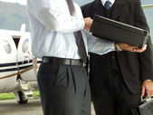 Business working at private jet — Stock Photo