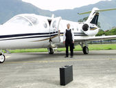 Businessman boarding a private jet — Stock Photo