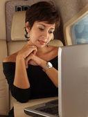 Businesswoman on a private plane — Stock Photo