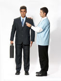 Doctor analizing an android businessman — Stok fotoğraf