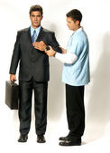 Doctor analizing an android businessman — Foto de Stock