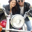 Couple enjoying a ride by motorcycle — Stock Photo #14610067