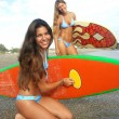 Stock Photo: Women surfers on beach. Two women holding surfboard.