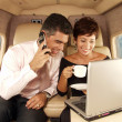 Business working at private jet — Stock Photo #14610435