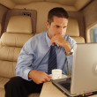 Business man working at private jet. — Stockfoto