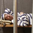 Prisoner in a prison cell. — Stock Photo