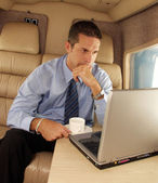 Business man working at private jet. — Stock Photo