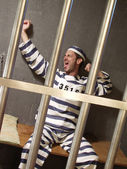 Exhausted prisoner in a prison cell. — Stock Photo