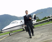 Businessman outside his private plane. — Stock Photo