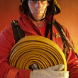 Firefighter in action. — Stock Photo