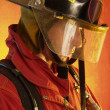 Stock Photo: Firefighter in action.