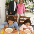 Hispanic family having breakfast in a kitchen. - Stock Photo