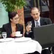 Young couple working in a cafe — Stock Photo