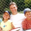 Family tennis portrait. - Stock Photo