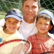 Family tennis portrait. — Stock Photo