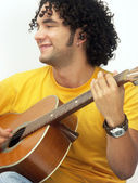 Hispanic young man playing guitar . — Stock Photo