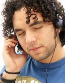 Young man listening music using headphones. — Stock Photo