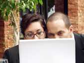 Young couple working in a cafe using a laptop. — Stock Photo