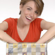 Expressive young woman opening a gift. — Stock Photo