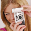 Young blonde woman taking a picture. — Stock Photo