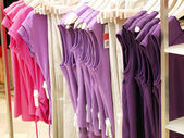 Fashion clothes in a shop — Stock Photo
