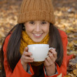 Stock Photo: Autumn hot drink womportrait.