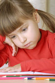 Sadness schoolgirl portrait thinking and studding. — Stock Photo