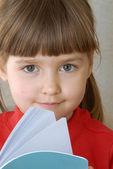 Little girl portrait reading a book. — Stock Photo