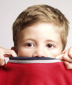 Expressive and funny kid portrait.Expression s of a little kid portrait covering nose. — Stock Photo