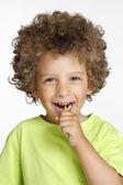 Little kid eating a lollipop portrait. — Stock Photo