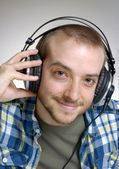 Young man using headphones,Dj listening music. — Stok fotoğraf