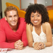 Young friends enjoying together in a living room. — Stock Photo #16959641
