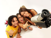 Young friends sharing and recording with a camcorder. — Stock Photo