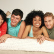 Young friends enjoying together in a living room. — Stock Photo