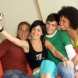 Stock Photo: Young friends enjoying together in a living room.