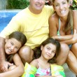 Stock Photo: Family by swimming pool