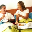 Hispanic couple having breakfast at bed. — Stok fotoğraf
