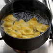 Boiling pasta on a pan - Stock Photo