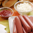 Couple sausages and possesor,ketchup,on ion and hotdog breads — Stock Photo
