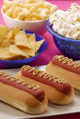 Hot dog and junk food — Stock Photo