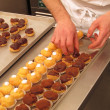 Постер, плакат: Chef preparing and organizing cupcakes
