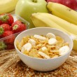 Stock Photo: Cereal corn flakes and fruit ingredients background